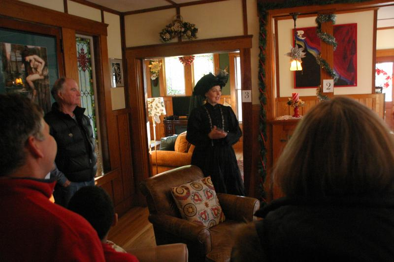 Donna Devlin-Young in period costume detailing the history of her historic home.