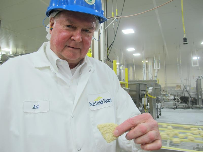 VP of Operations, Art Christianson, shows off a fish bite mid-process.