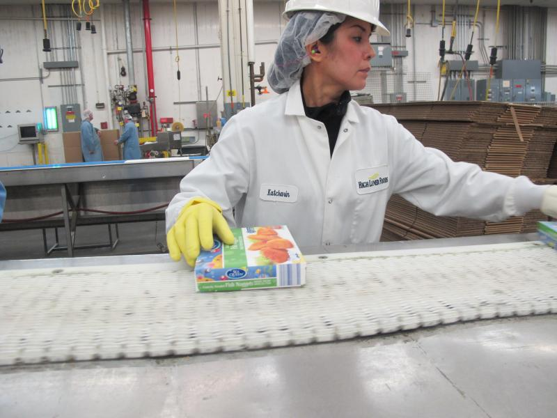 Finally, a worker packages the fish bites for shipment to retail grocery stores like Shaws, Costco, and even Whole Foods.