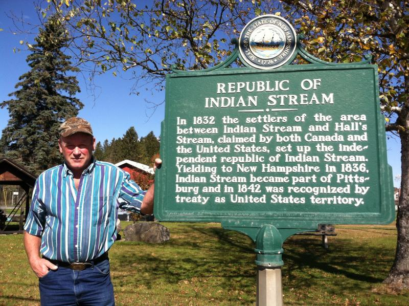 Pittsburg native Lindsey Gray stands next to the Republic of Indian Stream historical marker.