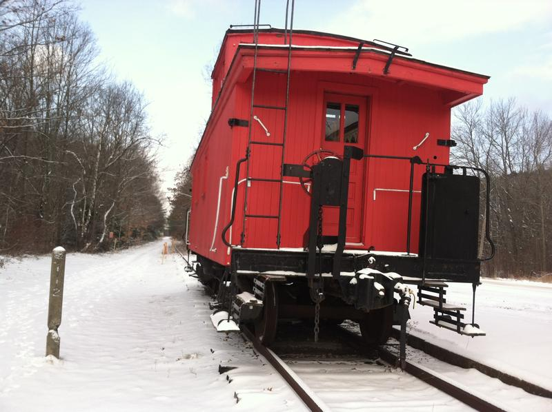 The station is on the Northern Railroad (later the Boston & Maine Railroad) line that ran from Boston to White River Junction in Vermont, and on to Montreal.