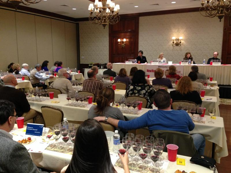 Attendees gather to taste a number of California wines arrayed on the tables.