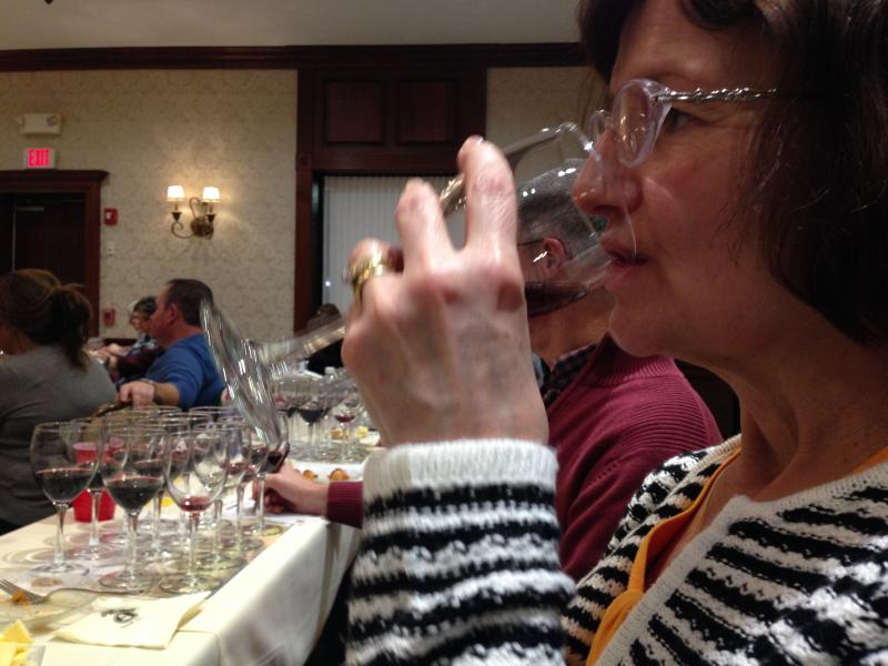 Corinne Szopa of Portsmouth smells a deep rosé of cabernet.
