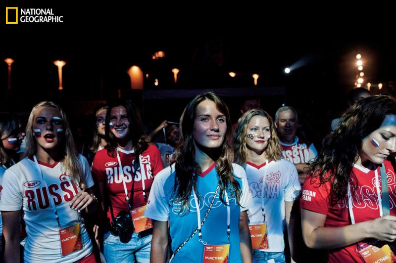 Russian athletes watch the opening ceremonies of the 2012 London Olympics on an outdoor screen. Putin hopes Sochi will showcase a newly resurgent Russia.