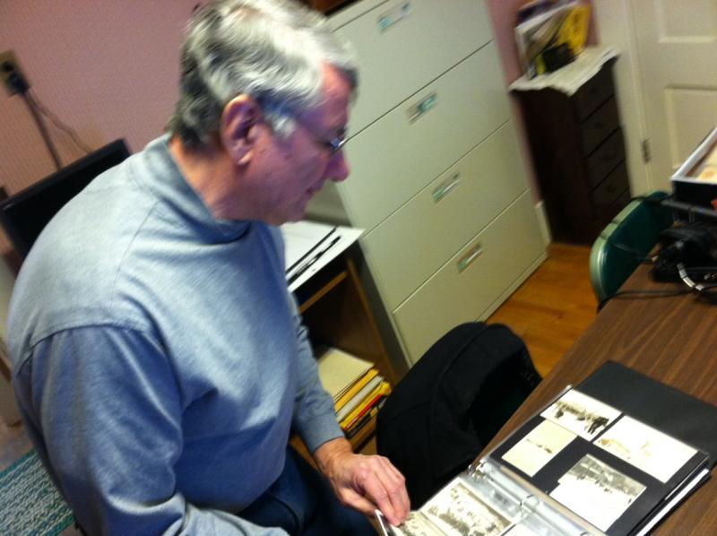 Walter Nadeau goes through the Berlin and Coos Historical Society's archive of pictures of the Nansen Ski Jump.