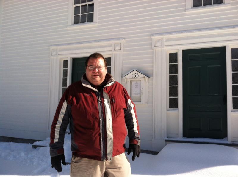 Ken Brummel stands outside the church.