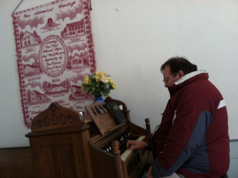 Pastor Ken Brummel plays the organ inside the church.