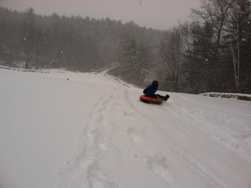 A sledder makes her way down one of the longer hills at Alexander Carr Park in Derry.