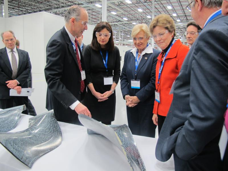 Albany International CEO Joe Morone shows carbon-fiber jet-engine blades to Senator Kelly Ayotte, Senator Jeanne Shaheen, and Congresswoman Carol Shea-Porter (not pictured).