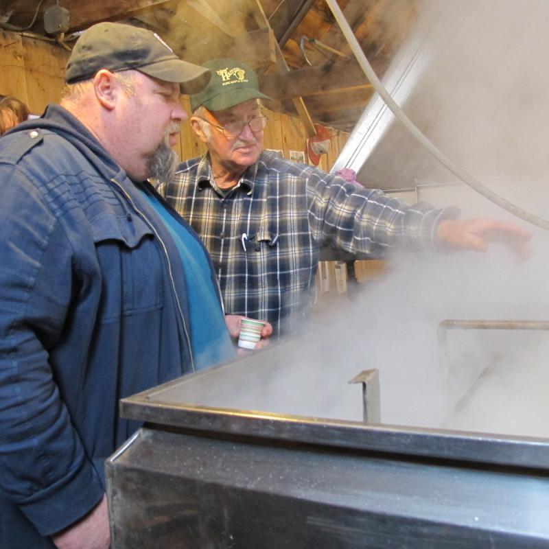 Courser Farm owner Gerald Courser of Warner explains the boiling process.