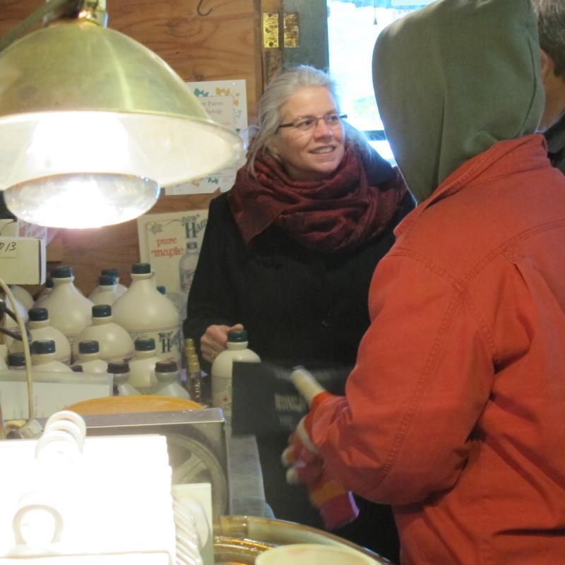 Penny Courser (right) greets a visitor.