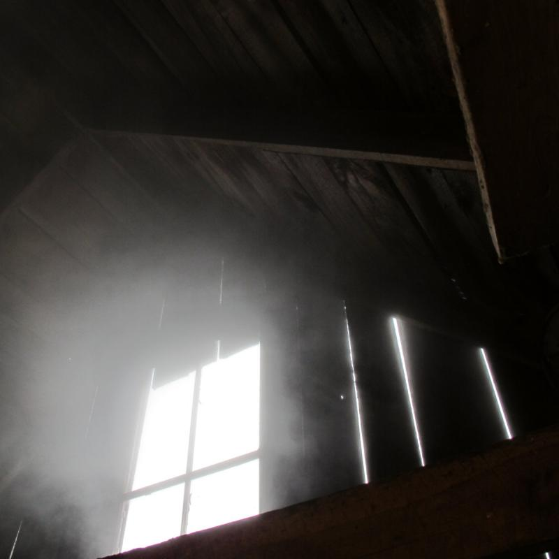Steam from the boiler diffuses light from an upper window.