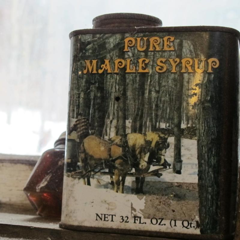 An old syrup can sits in the shack's window.