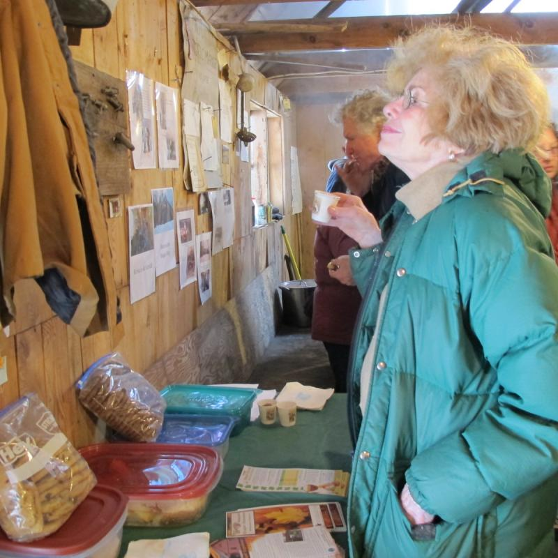 A visitor reads signage posted in the sugar shack.
