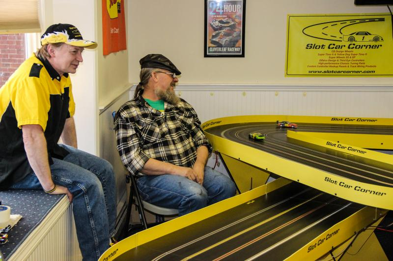 Dickie Pearson (left) watches a race at his shop.