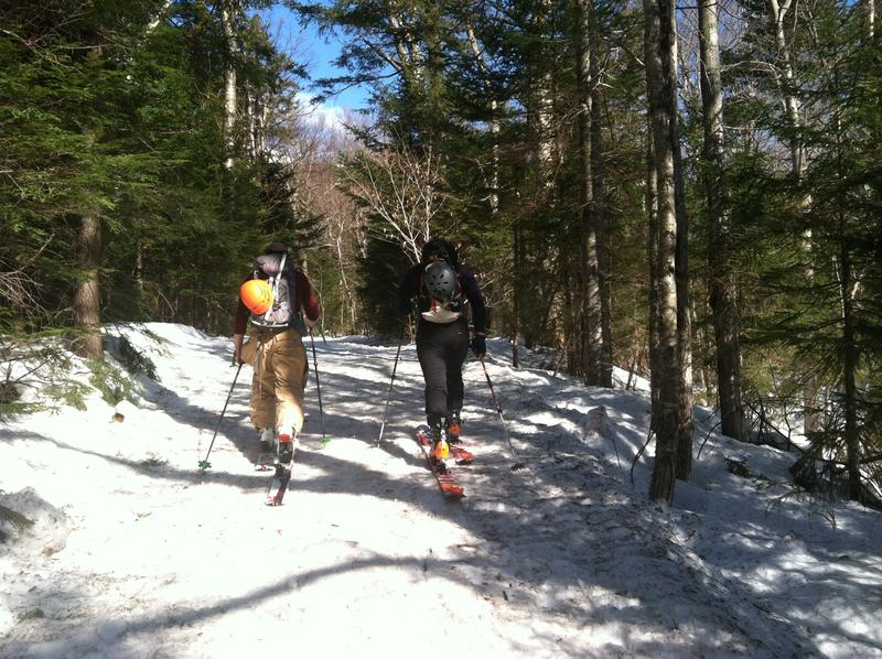 "It's slightly over three miles from the parking lot to the top of Tuckerman's Ravine. Most skiers hike with skis strapped to their backpacks, but increasingly skiers use backcountry gear to ""skin"" up the hiking trail."