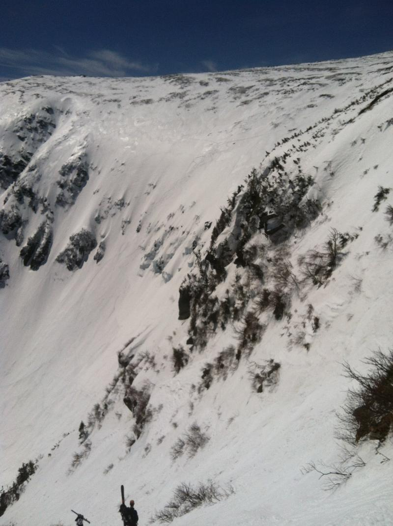 "The view of the Tuckerman Bowl from the top of ""Right Gully"". While there are many routes to take down into the bowl, all of them require skiing at least a 45 degree incline."
