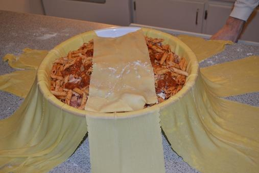 Fold noodles back over the top of the drum.
