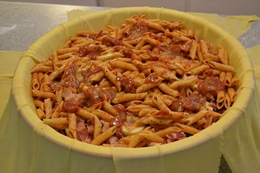 Finish with another layer of pasta, add a couple of beaten eggs.