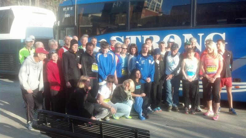 A group of Boston Marathon runners pose for a picture.