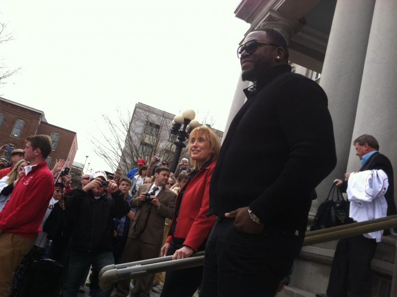 Governor Maggie Hassan and Red Sox slugger David Ortiz greet the crowd at the Statehouse on Monday.