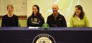 Steve Arkell, second in from the right, sits with his daughter Kim to his right at a ceremony in November. Kim Arkell signed a letter of intent to UVM.