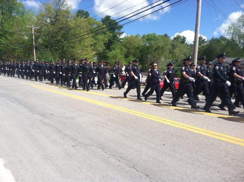 Thousands of police officers, firefighters from across New England marching in the procession for Officer Steve Arkell.