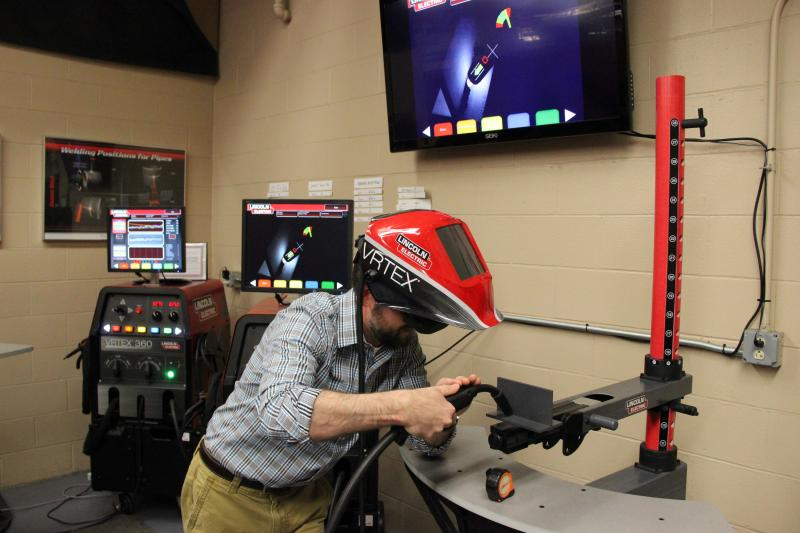 John Holt operating one of the virtual welders in the new welding lab.