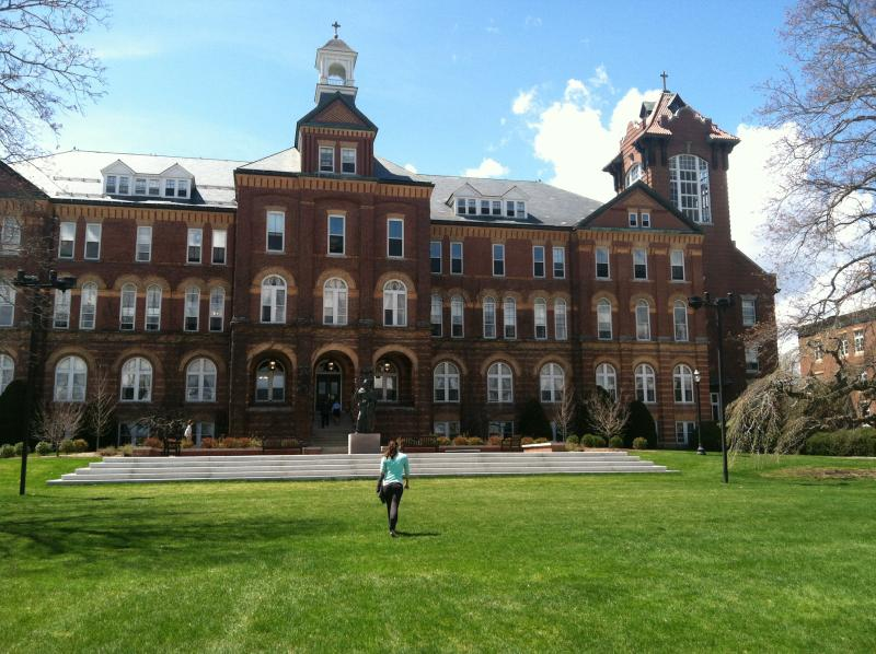 Emily Erickson walks to class on the green o Saint Anselm College
