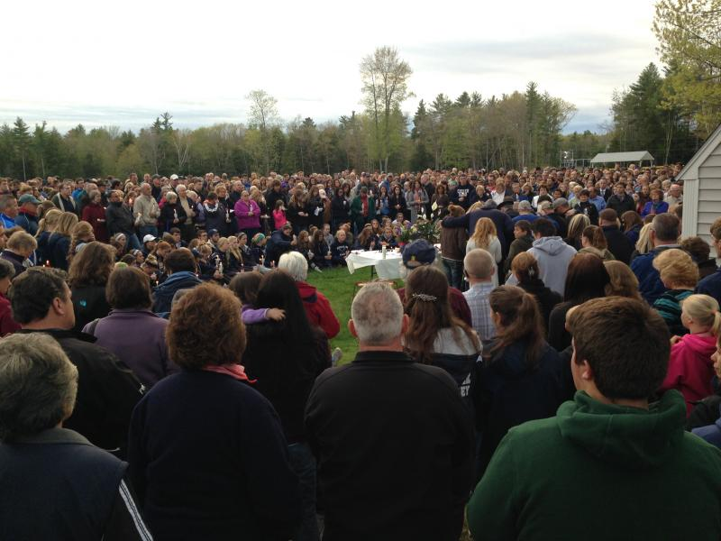 Hundreds stand vigil in a field behind the Brentwood Recreation Center.