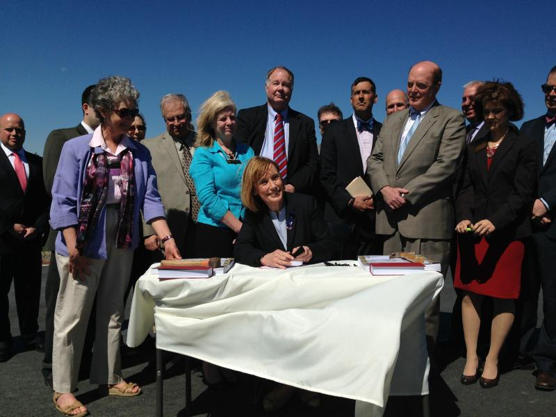 Governor Hassan signing the bill into law.