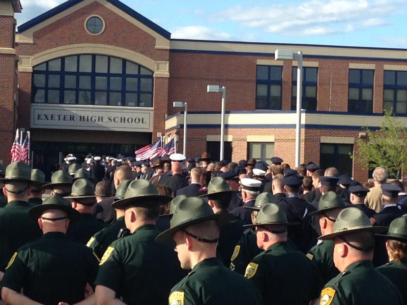 A sea of police march into Exeter High School.