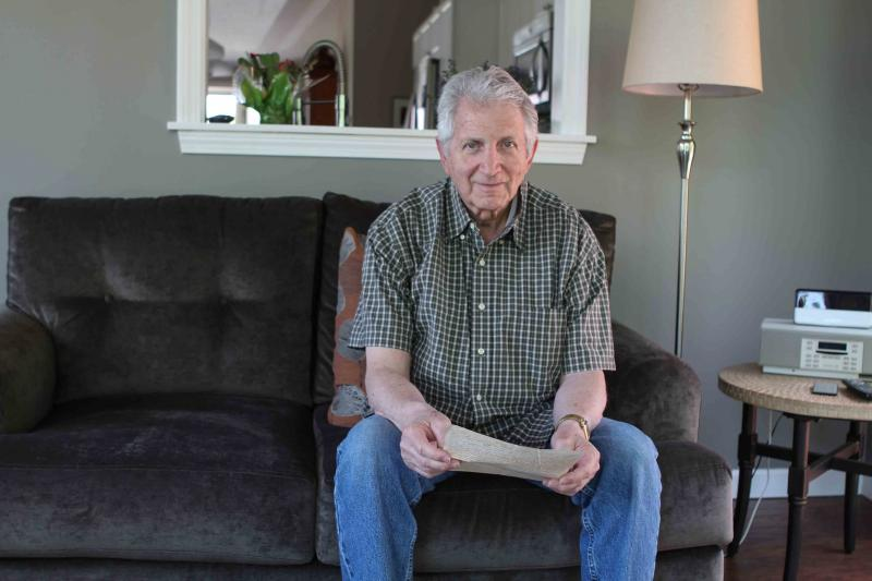 Fred Teeboom holds letter from aunt sent to death camp