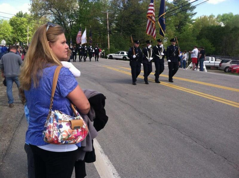Kim Walsh of Brentwood looks on with her two sons during the procession for fallen officer Steve Arkell.