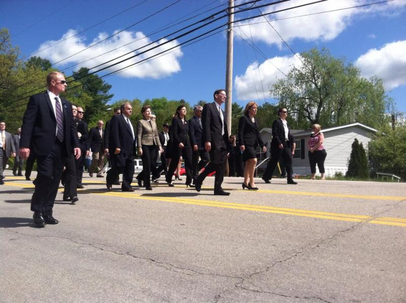 Senators Jeanne Shaheen and Kelly Ayotte march behind Governor Maggie Hassan
