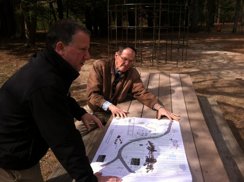 Legacy Playground organizers Eric Brand, left, and David Robbins, discuss their proposal near Greeley Park's current playground.