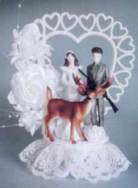Themed cake toppers are all well and good, but if you go with a hunting theme, try pointing the rifle at the deer - and not your bride's head.