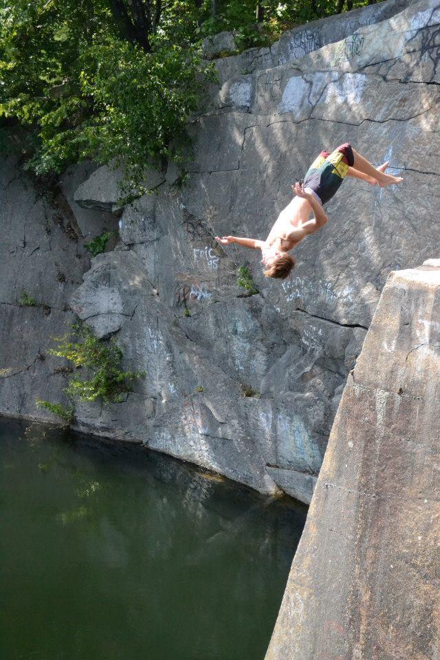 Duncan Lane backflips off a lower ledge.