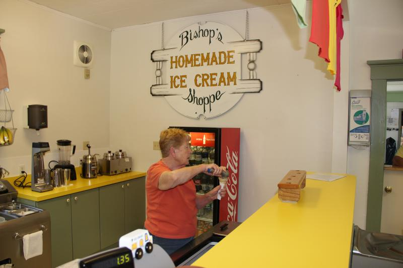 Barbara Quinn scooping ice cream.