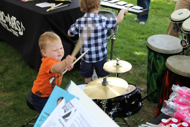 Cole Robeson tries out the drums for the first time.