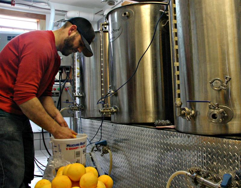 Saturday is normally when John Lenzini brews beer. Photo by Chris Jensen for NHPR