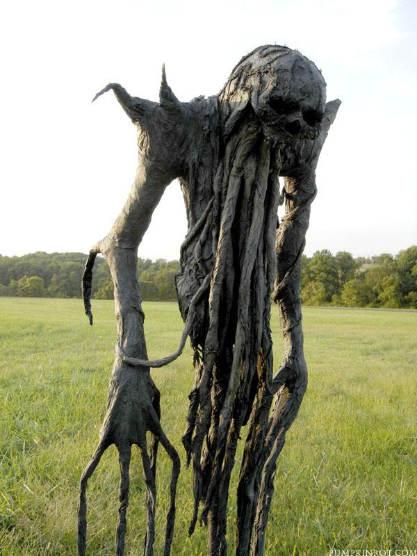 """Roots"" scarecrow. Made with paper mache in 2005."