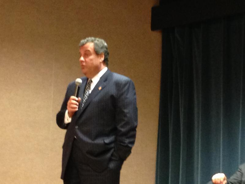 Christie speaking in front of a crowd of BAE employees, many of whom still remember Havenstein fondly.