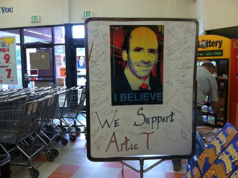 A sign inside the Concord Market Basket signed by customers in support of Arthur T. Demoulas.