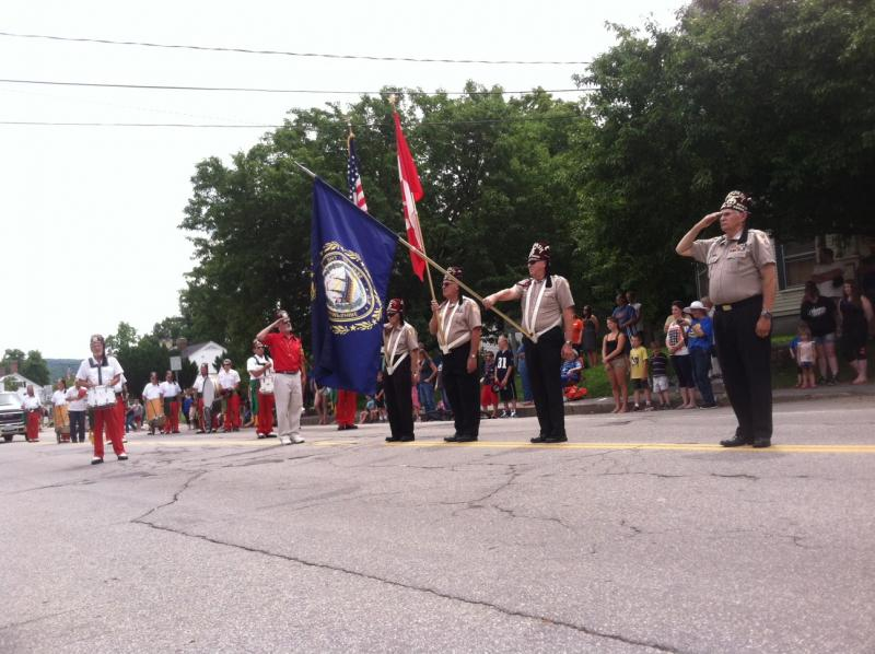 Pittsfield's Old Home Day parade stops for the National Anthem.