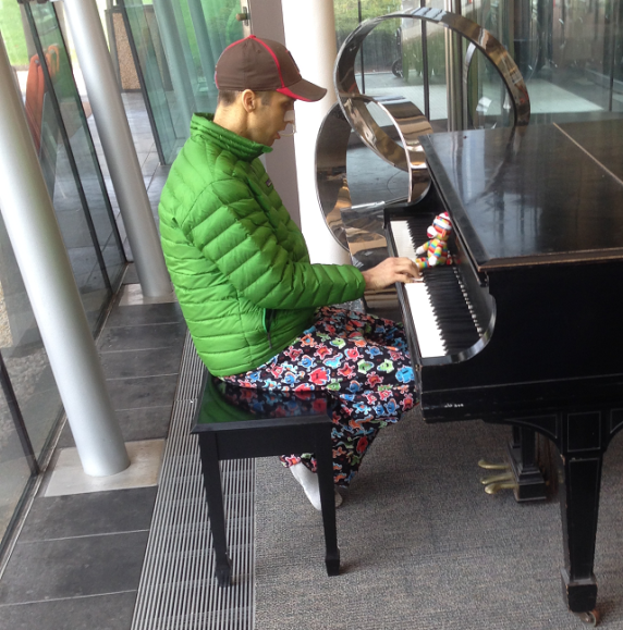 Derek playing piano in the lobby. Custom pants courtesy of his mother, Cindy.