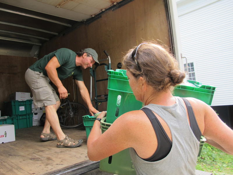 Kate Donald of Stout Oak Farm loads produce from her farm onto Andre Cantelmo's truck of Heron Pond Farm
