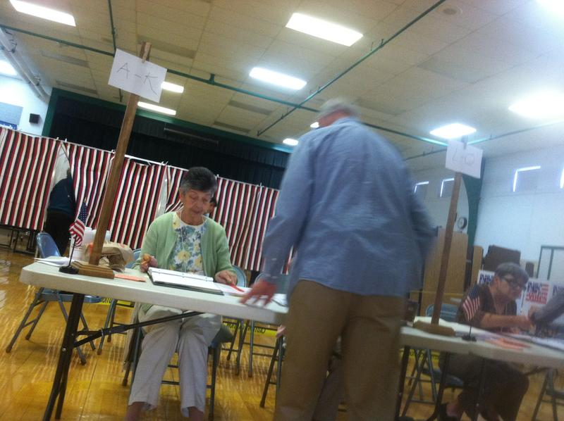 A voter checks in at the Charlotte Avenue School in Nashua