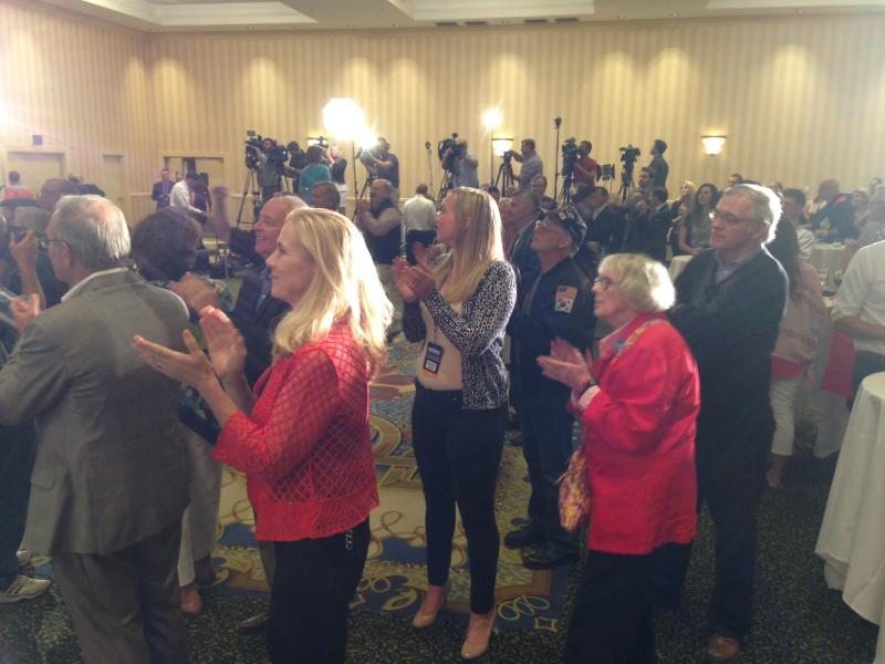 Supporters applaud as WMUR calls the race for Brown