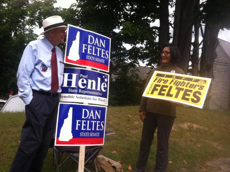 Supporters of state senate Democratic candidate Dan Feltes outside Concord's Ward 2